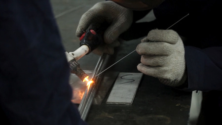 Welders working at the factory made metal. Clip. Welding at the factory.