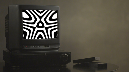 TV shows abstract pictures. TV shows a zombie video on the monitor. TV shows video hypnotizing consciousness.