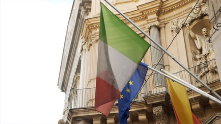 Flag of Italy and Europe Union Flag on the old roman building.