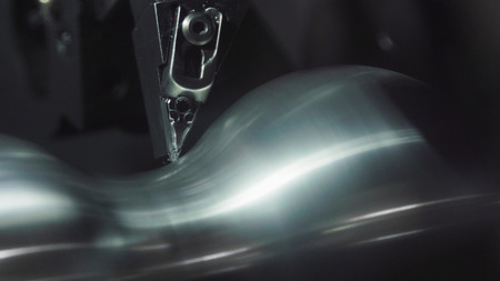 Metalworking CNC milling machine. Cutting metal modern processing technology. Metal precision machining machine.