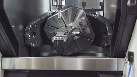 Metalworking CNC milling machine. Cutting metal modern processing technology. Modern processing machine.