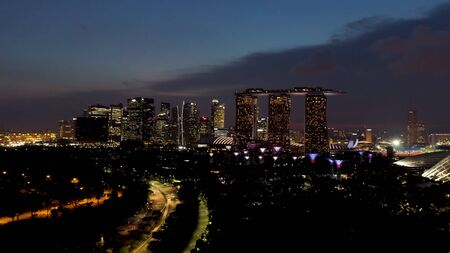 Singapore - 25 September 2018: Singapore Skyline at Night, Marina Bay Sands and modern buildings with many lights. Shot. Rear view of Marina Bay Sands and other beautiful buildings in night lights.