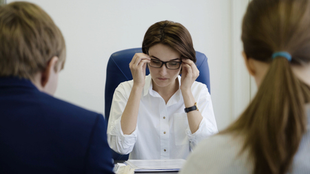 Woman boss punishes workers for work. Businesswoman unhappy with the work of employees in the office