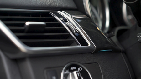 Luxury car interior details. Speedometer and steering wheel. Stock. Air heater vent in car dashboard interior close up
