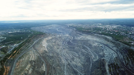 Coal mining at an open pit. Top view of the quarry. Dozers and trucks at buildings site on top aerial view Stock Photo