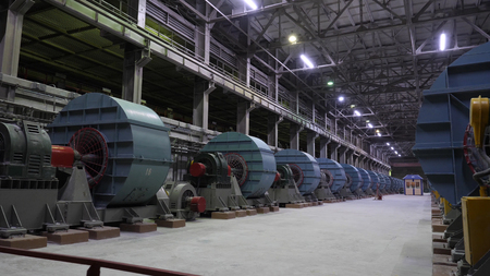 Copper crushing plant. Ball mills in large room of shop at mining enterprise. Crushing equipment at large mining plants