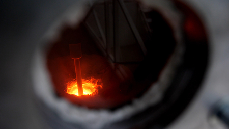 Close-up of melting furnace. Steel closed chamber metal melting furnace with glass round window to observe melting process.