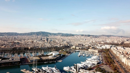 Huge cruise ship in the Bay.Stock. Top view of a huge city with a yacht port. A beautiful country to travel