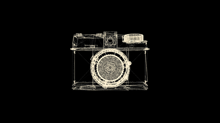 Old fashioned photo camera hologram rotating on black background. Yellow camera wireframe spinning and falling apart into the dust