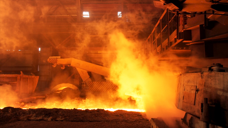 Hot steel being poured to the chute at the steel plant, heavy industry concept. Stock footage. Molten steel production in electric furnaces.