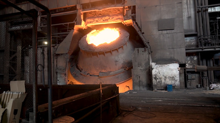 Metallurgical shop with big vat and molten steel inside, heavy industry concept. Stock footage. Hot steel vat at the metallurgical plant. Фото со стока