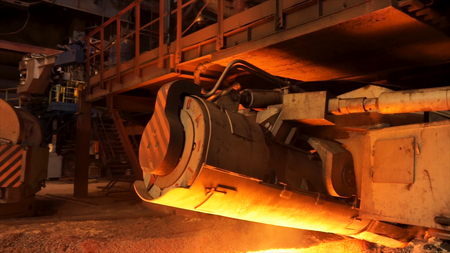 Steel production in electric furnaces, heavy industry concept. Stock footage. Close up for mechanism of the machine for steel melting. Standard-Bild