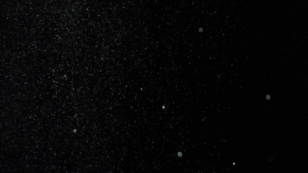 Bursts of white dust on black background. Stock footage. Explosion streams of white powder on black isolated background.