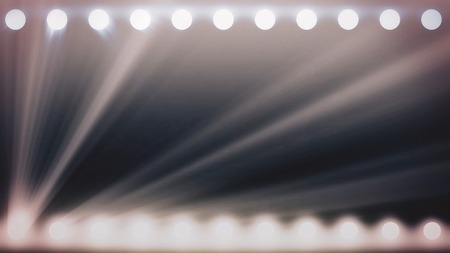 Abstract shining spotlights with white beams of light, monochrome background, seamless loop. Animation. Glowing soffits on black background, stage lighting concept.