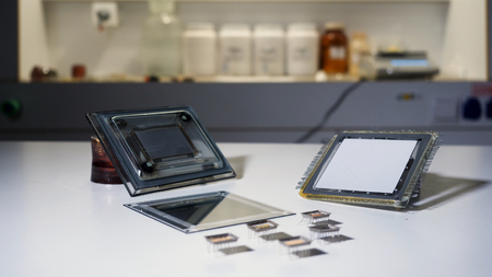 Close up for the equpment at the laboratory, sciene concept. Stock footage. Parts of the mechanism at the chemical lab lying on white clean table. Stock Photo