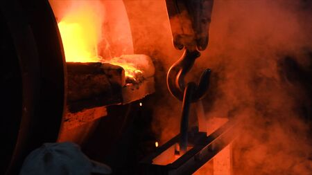Hot steel pouring at steel plant. Stock footage. Flowing metal at the foundry. Pouring of liquid metal in open hearth workshop.