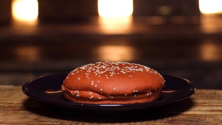 Burger bun on a plate. Stock footage. Appetizing bun for cooking a Burger. Delicious food