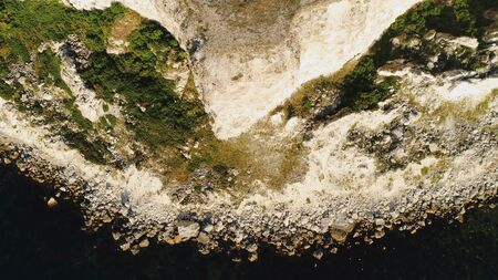 Aerial view of sea waves and fantastic Rocky coast. Shot. Top view of the rocky cliff by the sea Imagens - 128055167