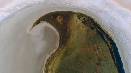 Top view of tropical island forest and water of north coast. Shot. Top view of the green island in the sea Imagens