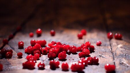Cranberry on wooden background. Stock footage. Fresh red cranberries on the table. Healthy eating concept 版權商用圖片