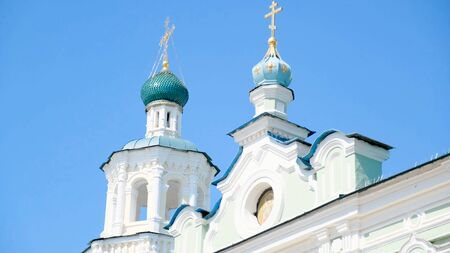 View of the white Church on a Sunny day. Stock footage. Old white Church on a blue sky background Imagens