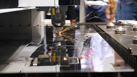 Cutting of metal. Media. Sparks fly from laser. CNC Laser cutting of metal, modern industrial technology