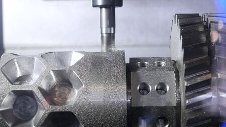 Metalworking cutting process by milling cutter. Media. CNC machine processes metal detail. Close-up of the metal workpiece processing on the latest machine
