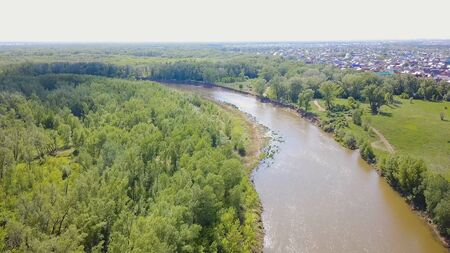 River valley in the countryside. Clip. Top view on river in the countryside. Beautiful summer time