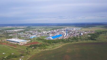 Top view of a huge industrial plant. Clip. Top view of factory slums with metal hulls and machines for the production of the coking industry
