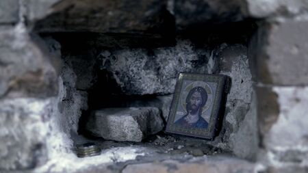Holy Icon in the rocky wall. Footage. Icon in frame for prayer Stok Fotoğraf
