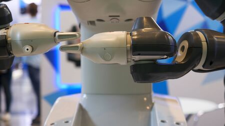 High technology, automated robot moving his hands at the EXPO, exhibition with the achievements of nations. Close up for modern robot hands in motion.