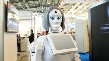 Woman robot with lights instead of her mouth and the touch screen at the exhibition. A robot with human face moving its mouth and eyes. Imagens