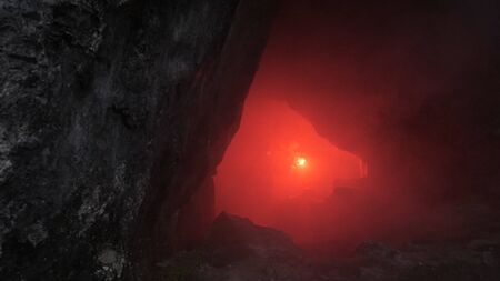 Traveler in dark cave. Stock footage. Man with red torch goes through narrow tunnels of dark cave. Dangerous and fascinating exploration of passages in rock cave