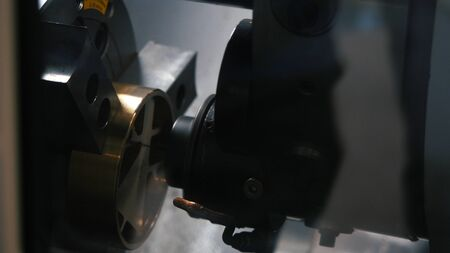 Close-up view of metal engraving automatic machine during operation on the factory. Media. Industrial and construction concepts