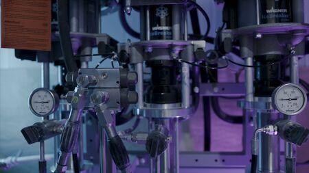 Parts pumps and pressure gauges in mechanism. Action. Steel parts with pipes and pressure gauges for pressure measurement in industrial equipment