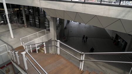 Top view of wooden stairs inside modern station building, transportation and infrastructure concept. Stock footage. Interior of the public building with stairs, spacious hall, and underpass. Imagens