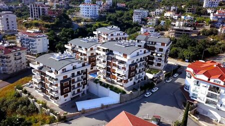 Top view of beautiful hotels with swimming pool on city background. Clip. Top view of beautiful modern hotels in resort town in summer