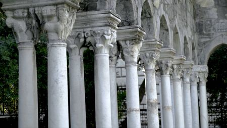 Rows of antique columns. Action. Beautiful white columns with various capitals. Antique architectural columns of old building or structure Foto de archivo