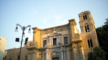 Beautiful antique white stone architectural building on sky background. Action. Ancient architecture of building is famous landmark of European city. Vacation in southern city with old architecture