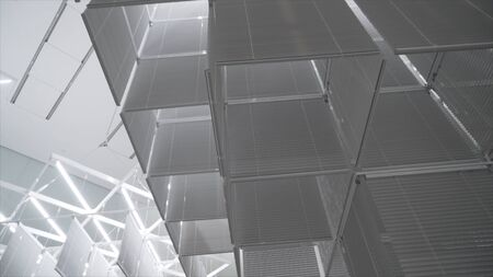 White room with bright light and suspended installations. Action. White room with unusual suspended installations and mirrors illuminated by bright lighting in Museum of modern art