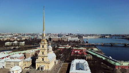 Saint Petersburg, Russia, panoramic aerial view of Petropavlovskaya Fortress and Neva river. Stock footage. Vasilyevsky Island, bridges of St. Petersburg, travel to Russian city.