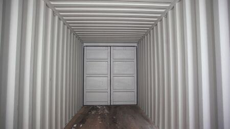 View inside of spacious empty cargo trunk of the truck with metal covering, transportation and trucking industry concept. Stock footage. Inside the metal container. Stockfoto