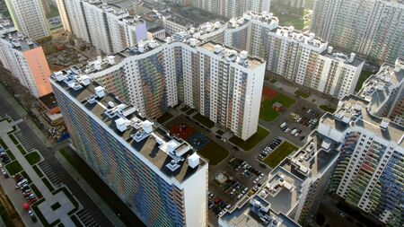 Top view of a new modern house in a new area. Motion. Beautiful view of the new residential complex.