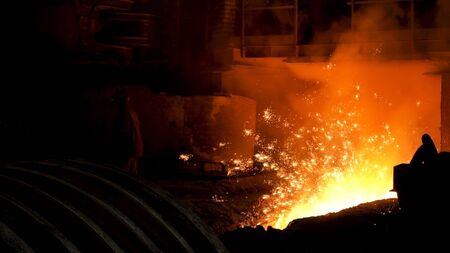 Iron and steel metallurgical plant, metallurgical production. Stock footage. Metal Melting process with many flying bright sparkles. Фото со стока