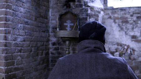 Man in a wheelchair in a ruined Church. Footage. Back view of a man in an abandoned Church. The concept of memories
