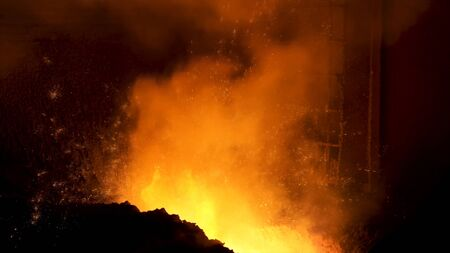 Close up of the process of hot steel production at the steel melting plant, heavy metallurgy concept. Stock footage. Hot shop with flowing molten steel in the chute.