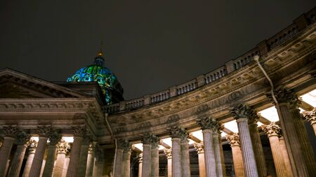 Night scene of Kazan Cathedral in Saint-Petersburg, Russia. Amazing historic building on black sky background, architecture concept. Stock Photo