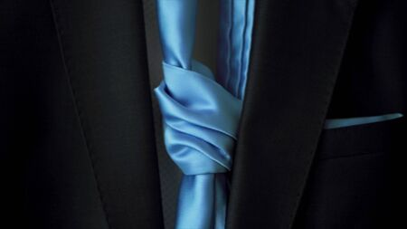 Male jacket with a blue tie, concept of business and official event. Close up of stylish blue men suit with a silk tie. Stockfoto