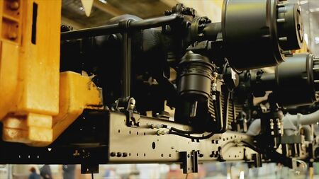 Close up of the process of car assembly at the production line. Stock footage. Rotating detail of the mechanism at the car assembly factory, construction concept.