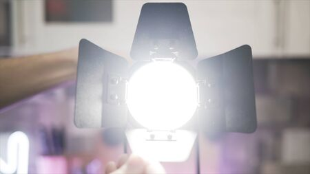 Close up of hands touching blades of tracking light. Stock footage. Male hands making spot light instead of diffused light, electric illumination of the room.
